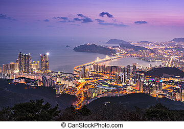 Busan, South Korea - Skyline of Busan, South Korea at night.