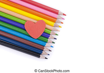 Paper heart on colored pencils