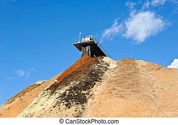 Stock Pile of Saw Dust - Stock Pile of Pulpwood at a Paper...