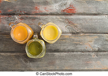 Healthy refreshing tropical fruit juice served in three...