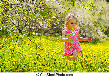 Little girl in the park - Little girl playing in the spring...