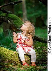 Little girl in the forest - Little girl in the dark green...