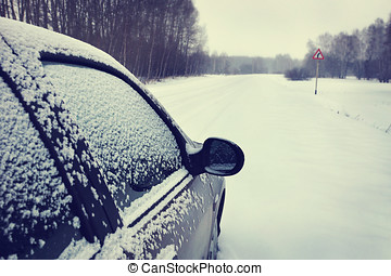 Car on a snowy road (focus on the mirror)