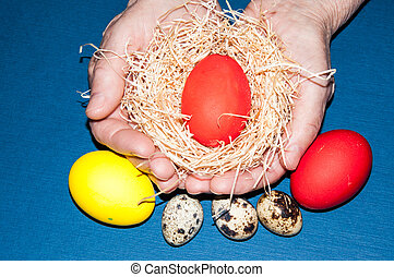 Easter egg in the hands of an elderly person