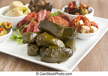 Dolmades - Greek dolmades wrapped with vine leaves feature...