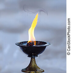 Candle in candlestick for worship genesha