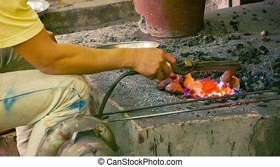 Making copper souvenirs. Workshop in Cambodia, Siem Reap -...