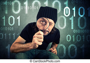Man looking through magnifying glass and inspecting binary...