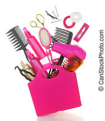 Various hairstyling equipment in shopping bag isolated on...