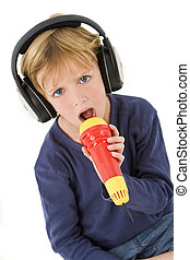 Future Pop Star - A young blond boy wearing headphones and...