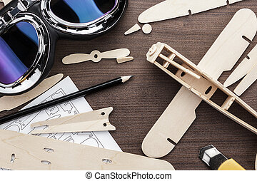 handmade airplane on brown wooden table - handmade airplane...