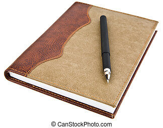 pen and notebook on a white background