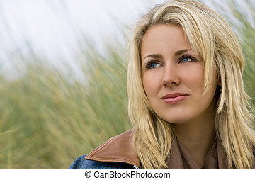 Natural Attraction - A beautiful blond haired blue eyed...