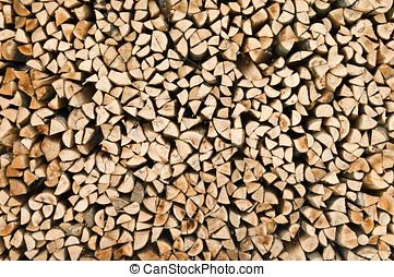 wood stack texture - many raw firewood logs stacked texture...