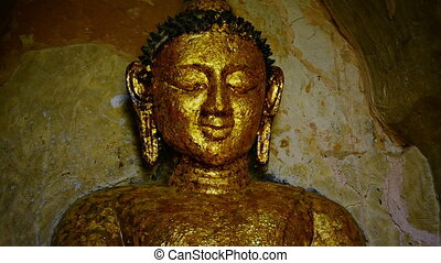 Face of the stone Buddha statue close-up. Bagan, Myanmar -...