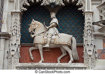 Statue of King Louis XII on the entrance to Chateau de...