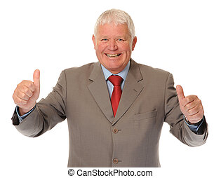 Successful mature businessman giving thumbs up