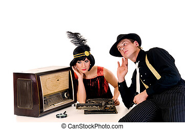 Retro couple radio - Attractive young couple, retro look...