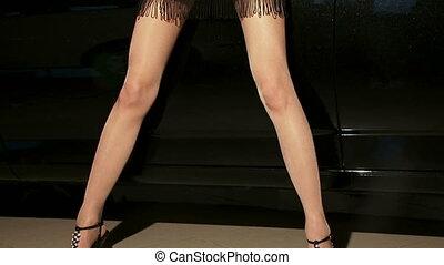 Sexy model posing near a car