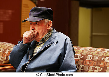 Elderly man coughing