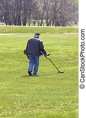 Exploration With Metal Detector - Retired man keeping...