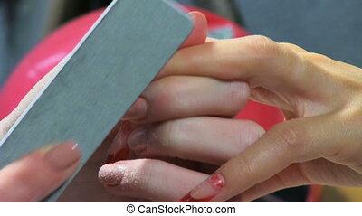 Manicure making Nice manicured woman palms