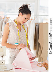 Concentrated female fashion designe - Concentrated young...