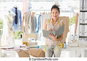 Beautiful female fashion designer w - Portrait of a...