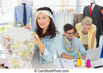 Fashion designers at work - Group of fashion designers at...