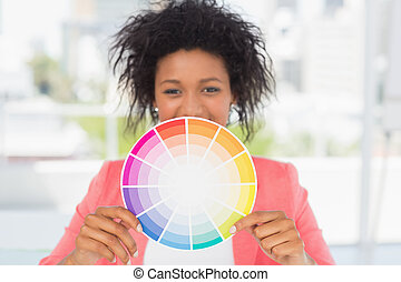 Beautiful young woman holding color wheel - Portrait of a...