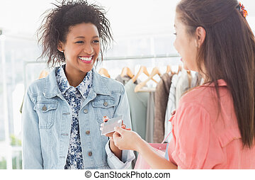 Customer receiving credit card from