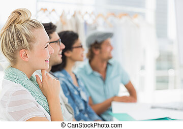 Fashion designers discussing designs - Group of fashion...