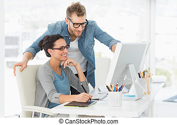 Young design team working at desk in creative office