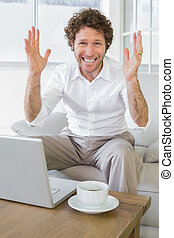 Worried well dressed man with laptop at home - Portrait of a...