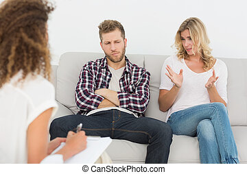 Woman speaking to therapist at couples therapy at therapy...