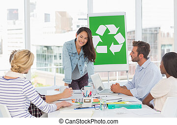 Happy team having a meeting about recycling policy in...