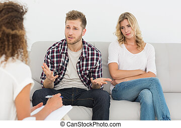 Man speaking to therapist at couples therapy
