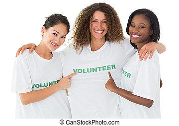 atraente, equipe, voluntários, sorrindo, câmera