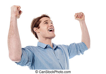 Young man celebrating success with arms up - Confident young...