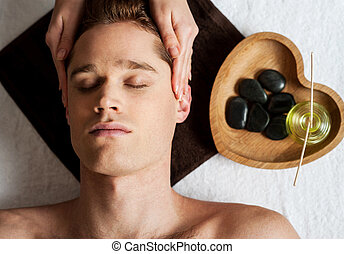 Head massage on man in the spa