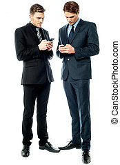 Two businessmen using the phone - Two business executives...
