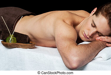 Young man in spa massage salon