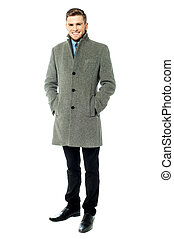 Corporate guy wearing long overcoat - Young businessman...