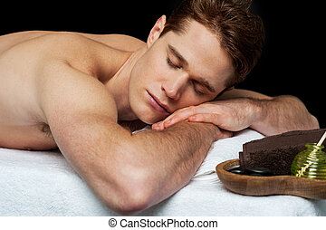 Handsome man relaxing at the spa - Handsome man resting in a...