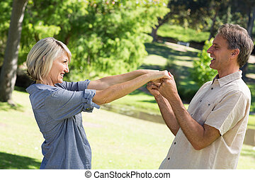 Romantic couple dancing in park