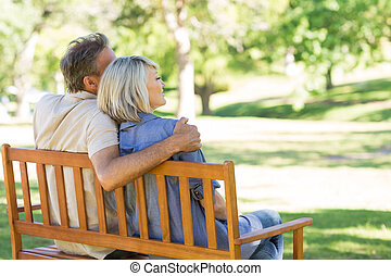 Couple sitting on park bench