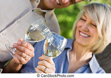 Couple toasting wine glasses - Midsection of happy couple...