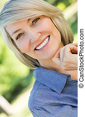 Smiling woman in park - Tilt image of smiling woman with...