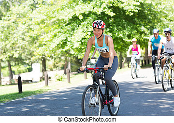 Cyclists riding bicycles