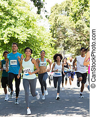 Marathon athletes running - Group of marathon athletes...